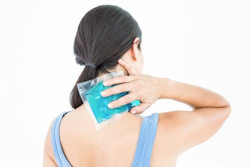 Woman applying an ice pack to her neck