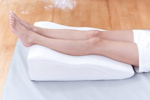 Legs elevated on pillow