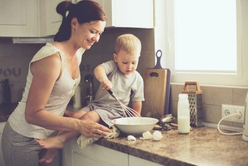 mother and baby cooking together