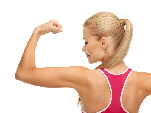 A woman flexing her arm
