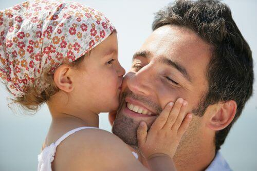 Daughter kissing father on cheek strong woman