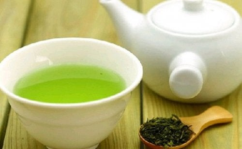 cup and pot of green tea