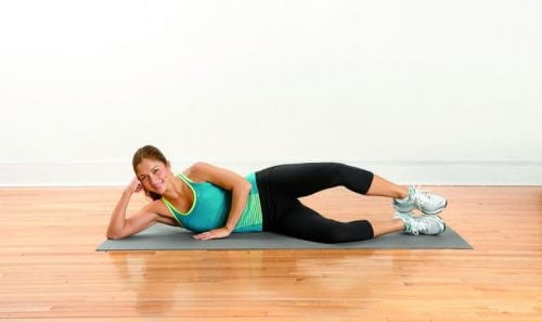 Woman doing ler raising exercises for leg pain