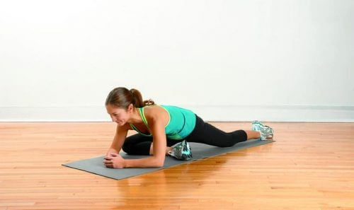 Woman doing stretching exercises for leg pain