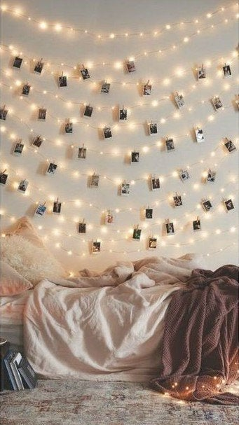 Photographs and lights on a wall