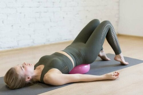 A woman doing yoga for muscular pain.