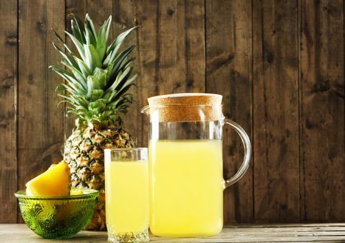 A jar and a glass of fermented pineapple juice