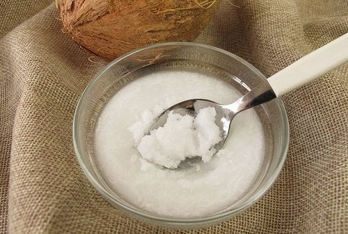 Bowl of solidified coconut oil white solid cleanse face with natural oils
