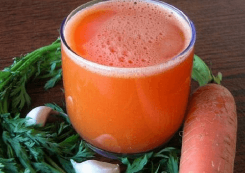 a glass of carrot juice for the anti-stretch mark smoothie