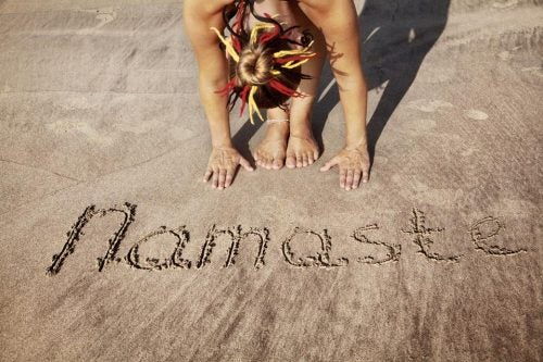 Namaste written in the sand