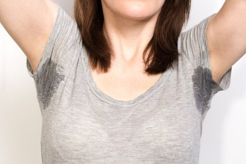 A woman with a lot of underarm sweat.
