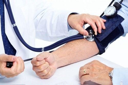 Taking someone's blood pressure.
