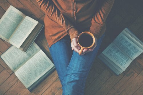 Girl drinking coffee reading books limiting thoughts