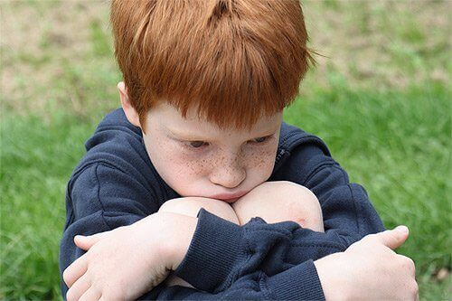 Redhead young boy upset identify a child abuser
