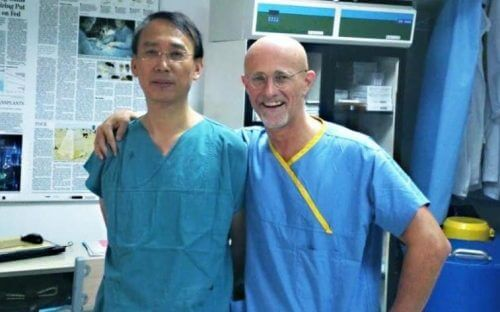A surgeon with his patient.
