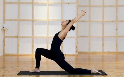 A woman doing the dove pose.