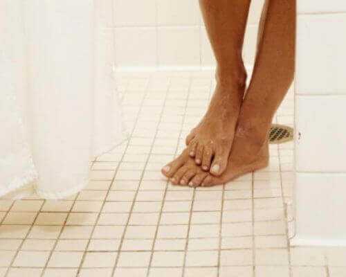 person's feet  in a shower