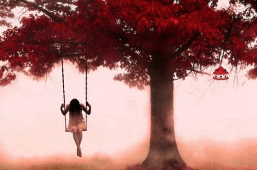 A lonely person on a swing.