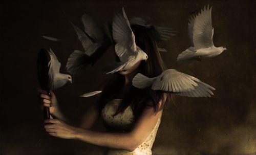 Woman with bird around her head to simbolize the Cassandra complex