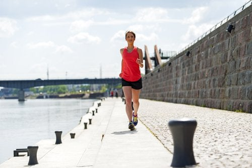 Woman exercising near river