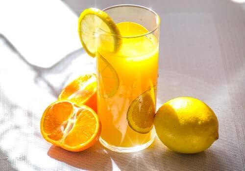 A glass of lemon and orange water.