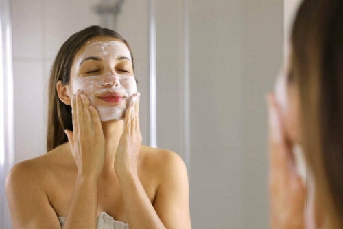 A woman trying to shrink her large pores by washing her face.