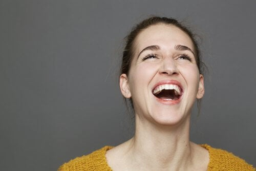 Woman laughing.