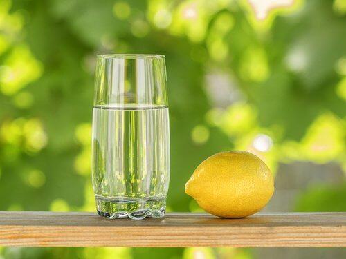 Lemon with glass of lemon juice