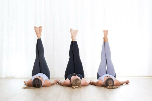 Three women with their legs up high.