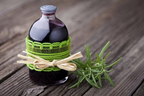 Rosemary sprig and bottle