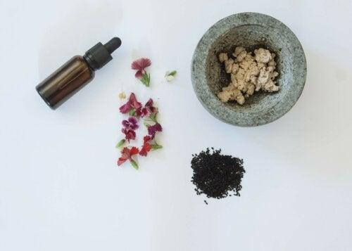 black tea, oil, flowers, ingredients to make a homemade cream