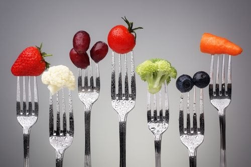 healthy fruits and vegetables on forks