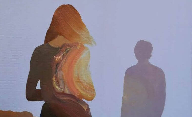 The shadows of a woman and a man.