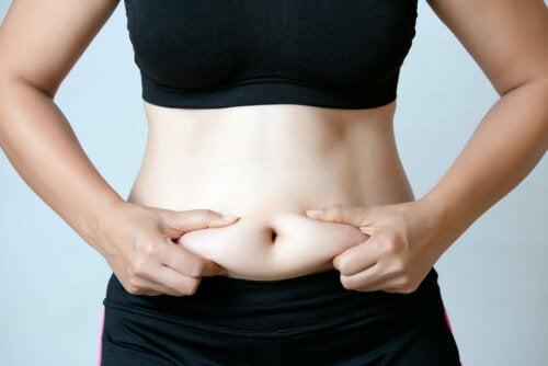woman grabbing her stomach skin