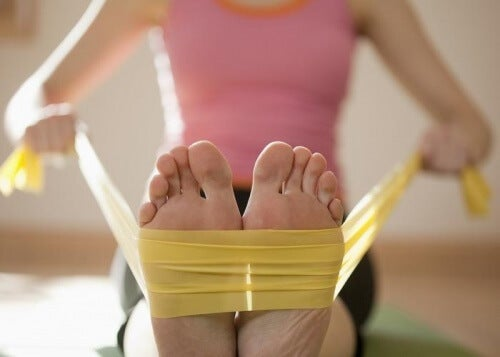 A woman doing stretches with her feet.