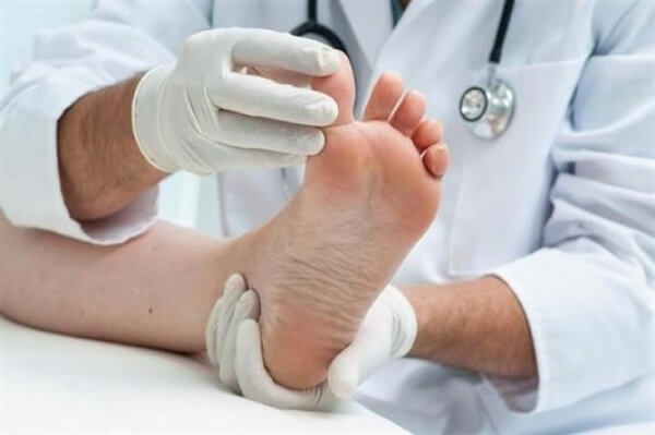 doctor examines foot and toes for stronger feet