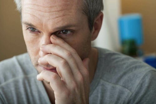 A man in pain due to nasal congestion.