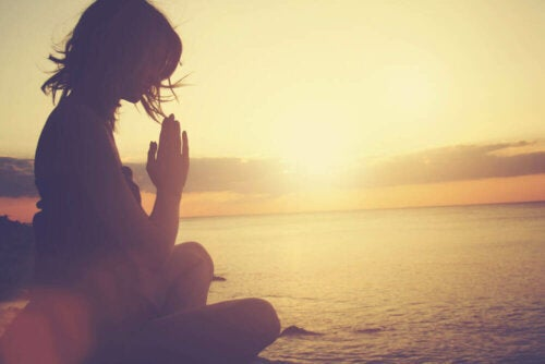 A person meditating.