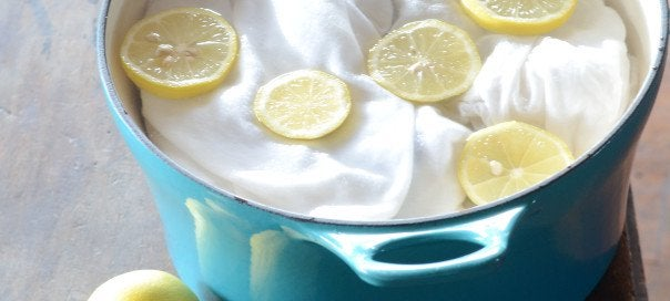 use lemon as a stain remover with lemons and fabric