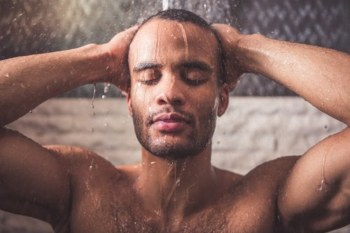 man taking a shower to reduce neck pain