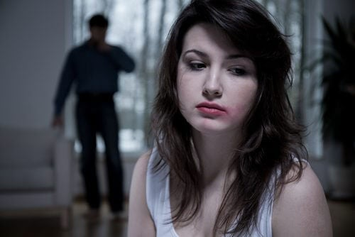 A woman in an abusive relationship.