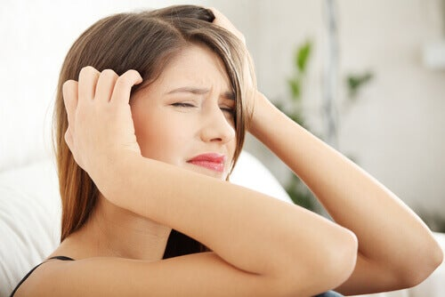 young woman with stress headache in pain