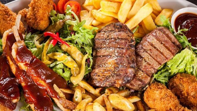 unhealthy food such as fries, steak, and fried chicken that can cause sagging breasts