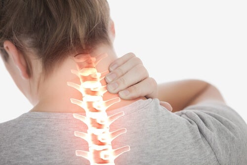 woman with neck pain who needs magnesium oil