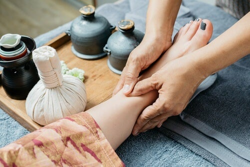 woman's leg massage at a spa for joint pain relief