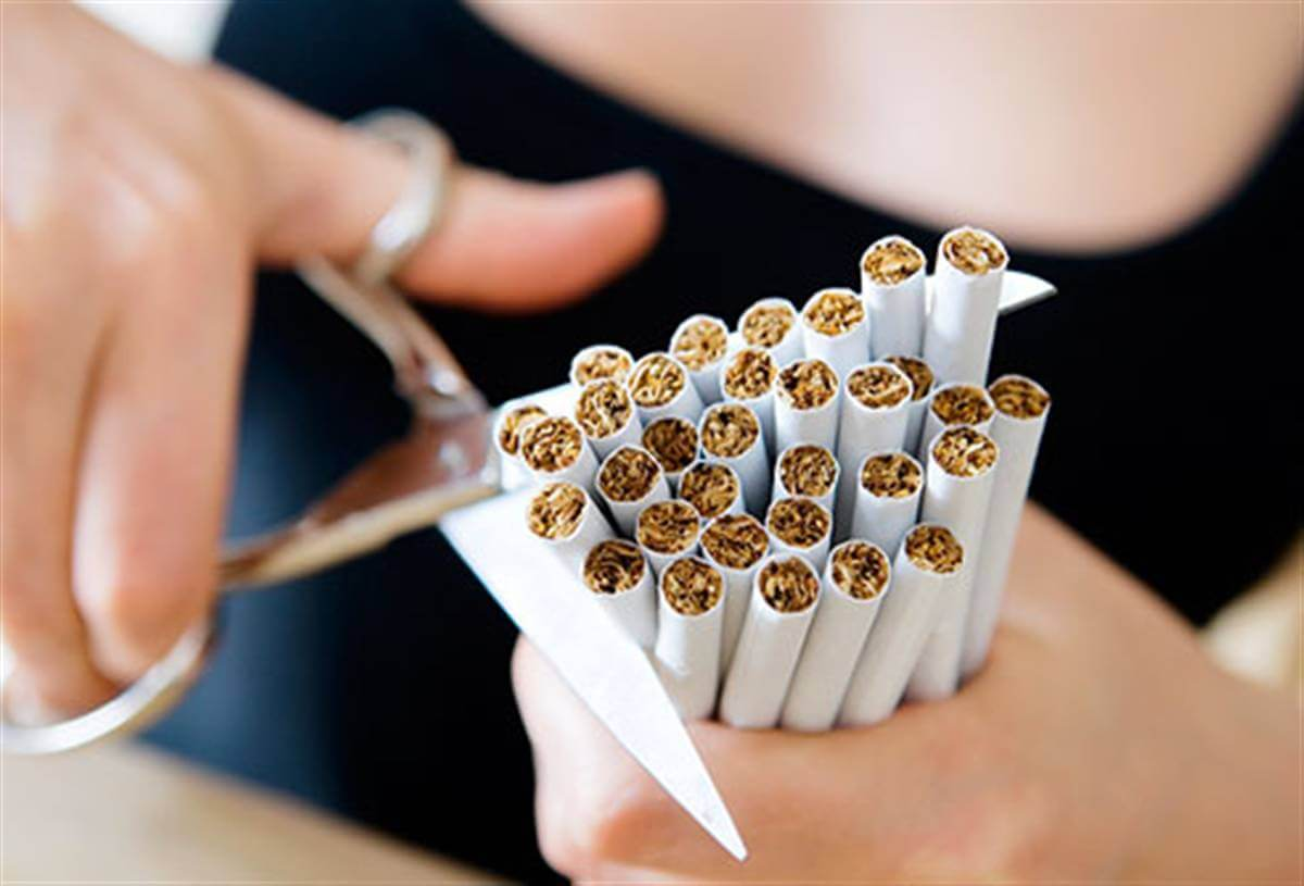 how to quit smoking: cutting cigarettes