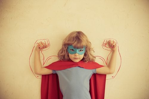 Child in costume and mask playing super strength benefits of fish oil kids health