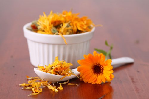 Marigolds in ramekin spoon