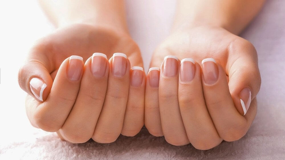 french manicure on nails with apple cider vinegar beauty secrets