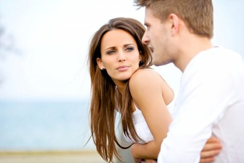 man and woman talking in serious conversation